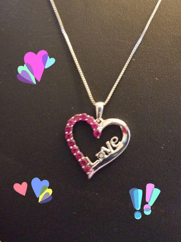 Sterling Silver Pink topaz heart with with the word Love scripted in the middle,wow Mother's day is only 4 weeks away.