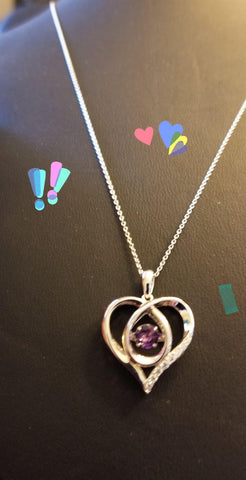 Sterling Silver Heart with a center Amethyst and surrounded with cubic zirconia's, wow Mothers day is only 4 weeks away.