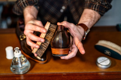 Using a horse hair brush for the final buffing of the oils and upper