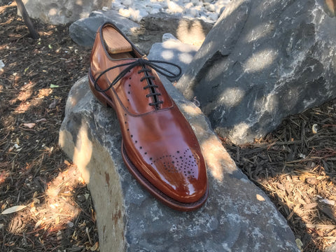 Single Allen Edmonds Weybridge in Walnut front on rocks mirror polished with All Natural Non-Toxic Pure Polish Products