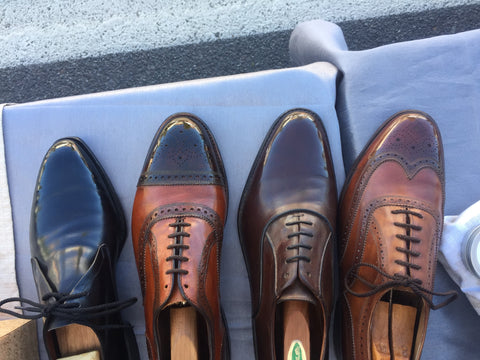 Back Middle View of Shoe Shine Group Crockett & Jones Derby, Navyboot Calfskin Oxford, Allen Edmonds Strand with custom patina, and Vintage Florsheim Imperial Wingtips