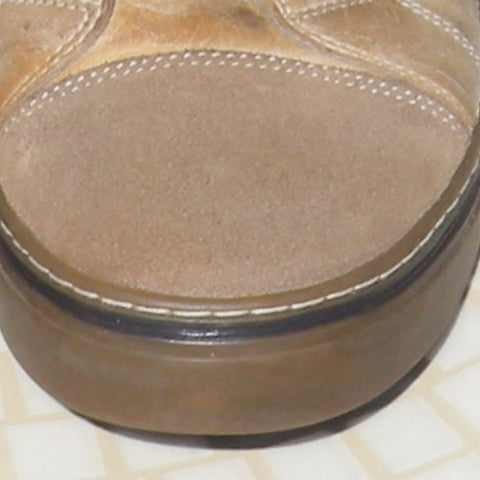 Final image of a clean suede cap-toe