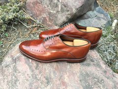 Mirror Shined Allen Edmonds Walnut Weybridge on a rock profile