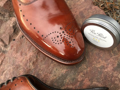 Reflection of Pure Polish High Shine in toe of Mirror Shined Allen Edmonds Walnut Weybridge Oxford Leather Shoes