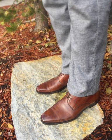 Men's Style Shot - Brown & Grey with Fall Leaves, Magnanni Derbies and Agave Denim Slacks