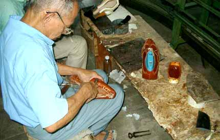Craftsman making handmade shoes