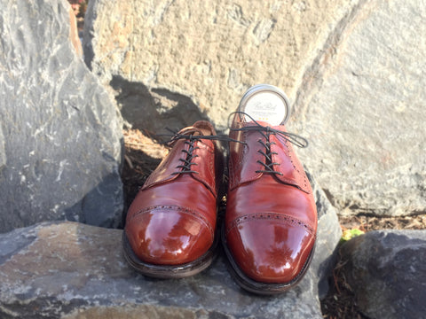 Lensing and Mirror Shining with High Shine and Black Wax derby shoes outdoors on the rocks