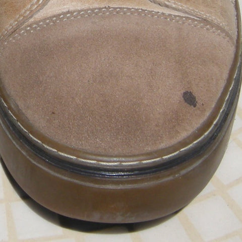 Small spot of oil on the toe of a suede shoe