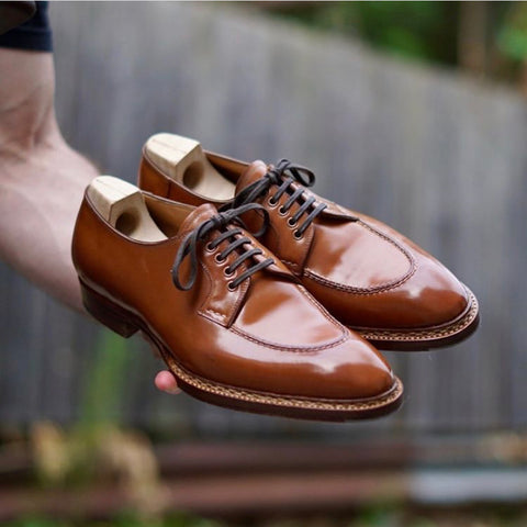Saint Crispins Natural Shell Cordovan Apron Toe Derbies being handled by DE Shellvedge