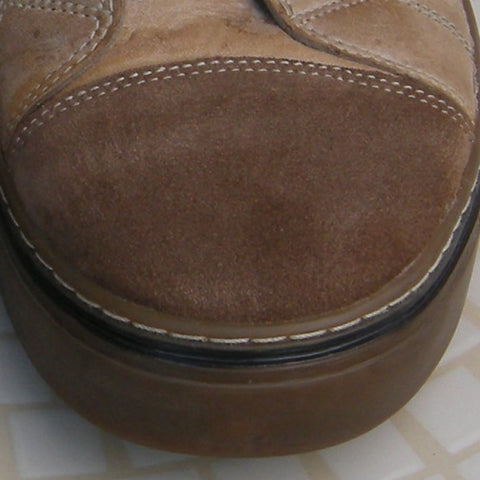 Damp suede toe cap of a boot