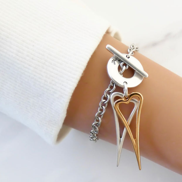 Twin open pointed hearts bracelet, silver and rose gold