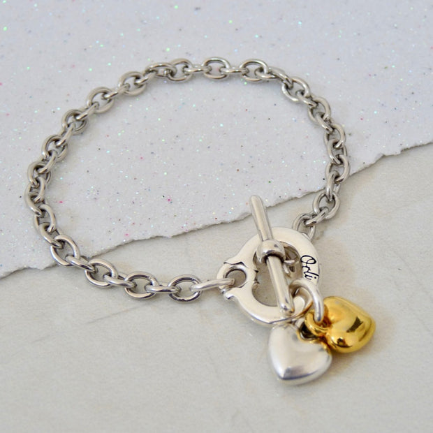 Twin puffed hearts charm bracelet, silver and yellow gold