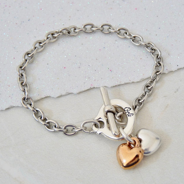 Twin puffed hearts charm bracelet, silver and rose gold