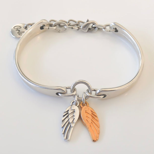 Twin angel wings brangle, silver and rose gold