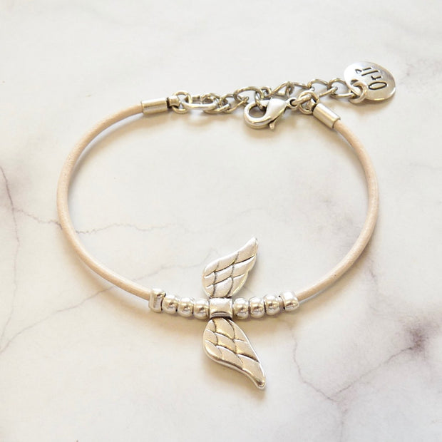 Leather bracelet with angel wings, silver and nude - Orli Jewellery