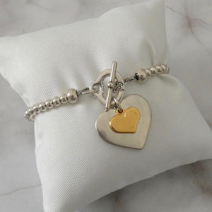 Smooth heart and mini heart beads t-bar bracelet, silver and gold