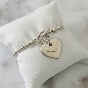Smooth heart and mini heart beads t-bar bracelet, all silver