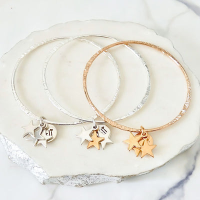 Thin bangle with triple star charms