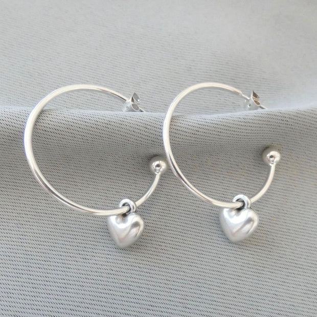 Puffed heart large hoop earrings, silver