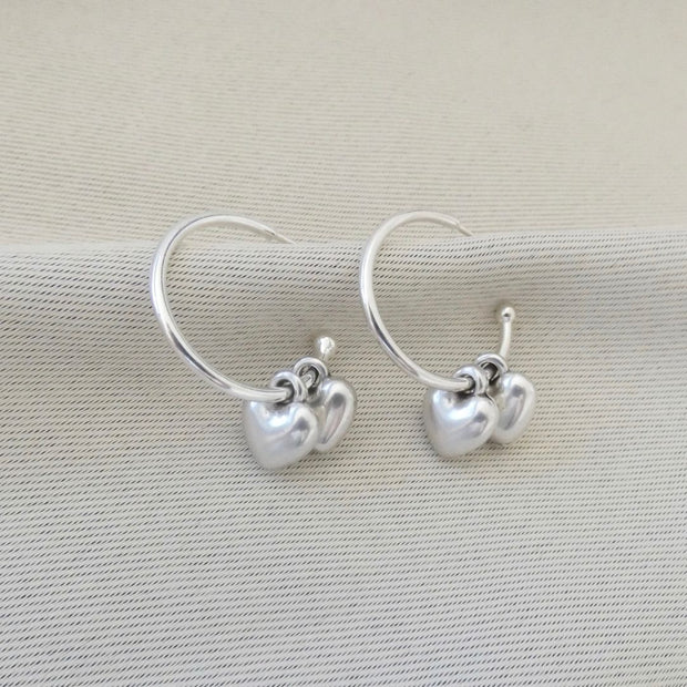 Twin puffed heart hoop earrings, silver