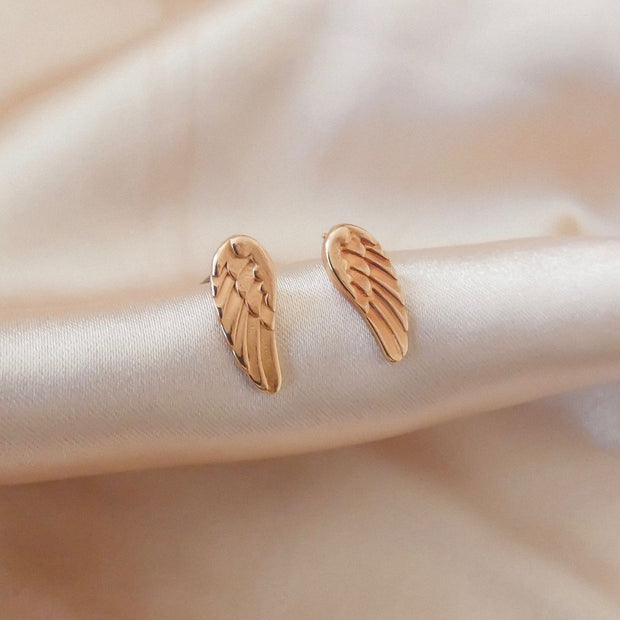 Open heart and crystal heart stud earrings, rose gold