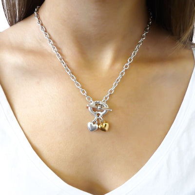 Twin puffed hearts necklace, silver and yellow gold