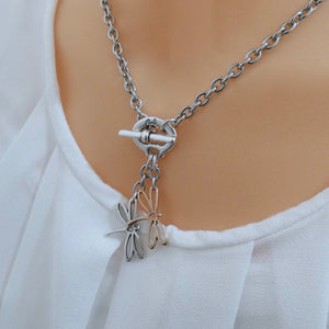 Open dragonflies necklace, silver and rose gold