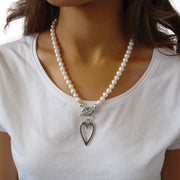 Waterpearl necklace with long open heart