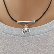 Twin angel wings leather strand necklace, silver and black