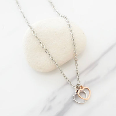 Twin tiny open hearts fine necklace, silver and rose gold