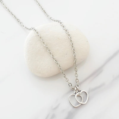 Twin tiny open hearts fine necklace, silver