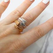 Twin angel wings expandable ring