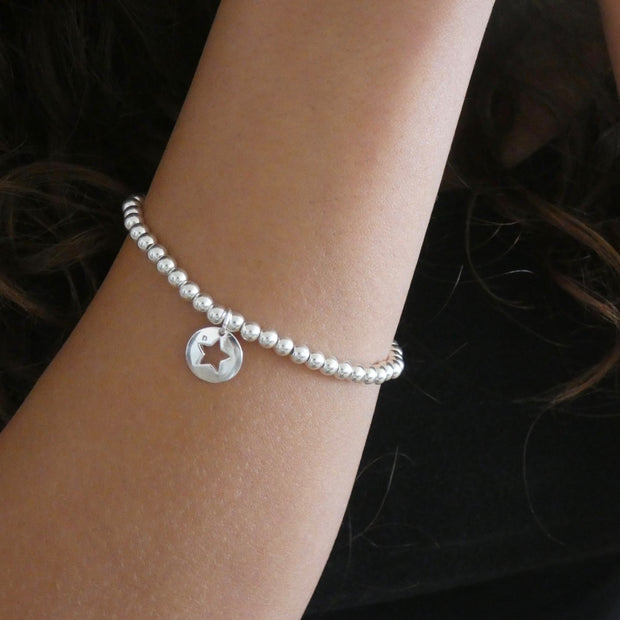 Sterling silver beads bracelet with cut out star charm