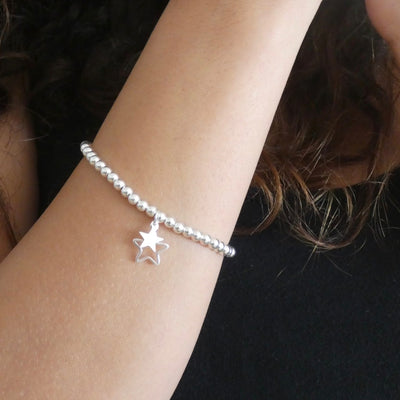 Sterling silver beads bracelet with open star and mini star charms