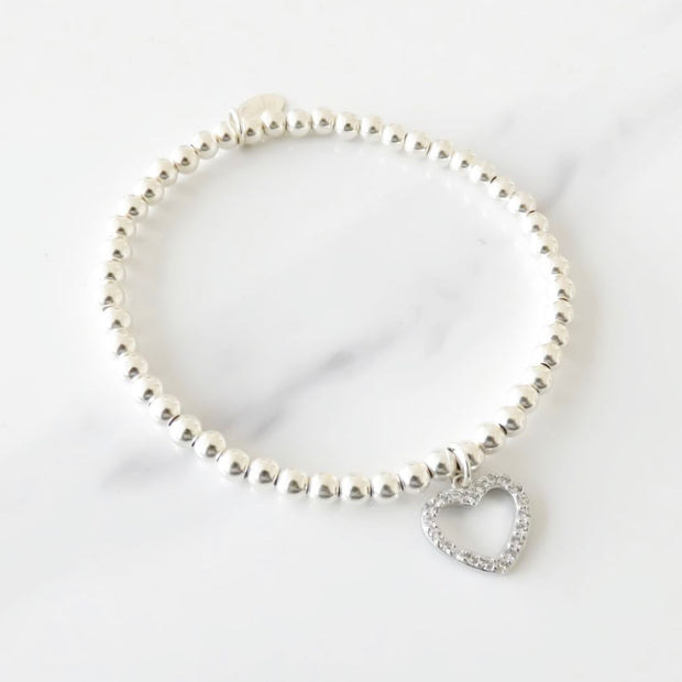 Sterling silver beads bracelet with large open crystal heart