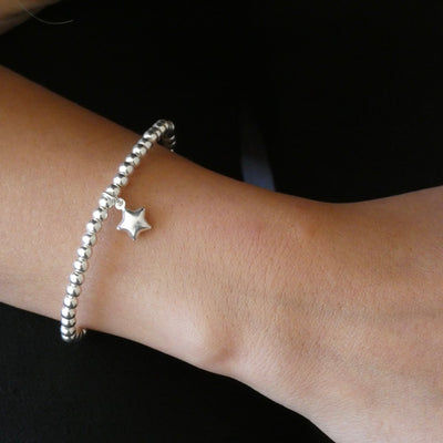 Sterling silver beads bracelet with puffed star charm