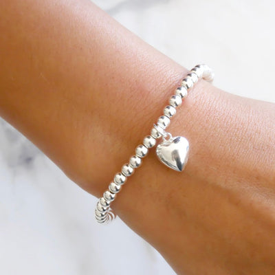 Sterling silver beads bracelet with puffed heart charm