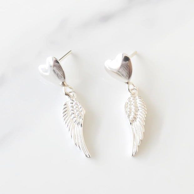 Sterling silver heart and angel wing stud earrings