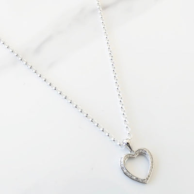 Sterling silver necklace with twisting crystal heart