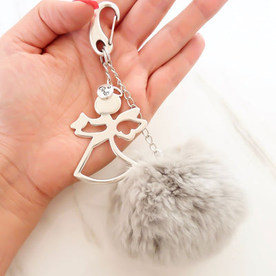 Angel and pompom keyring