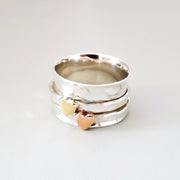 Sterling silver spinner ring with two tone hearts