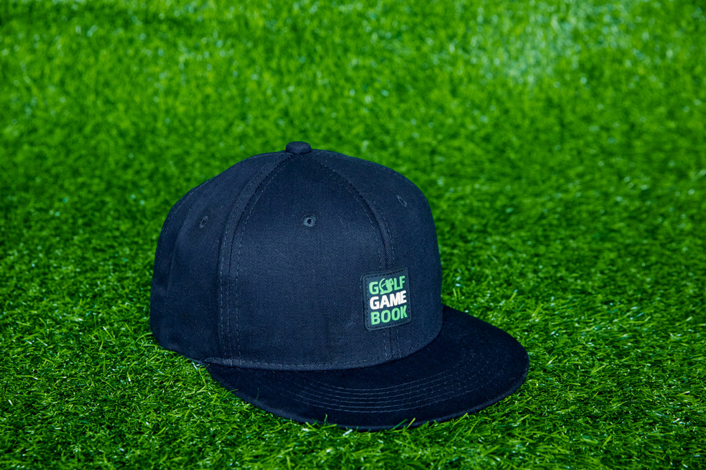 Black cap with green logo