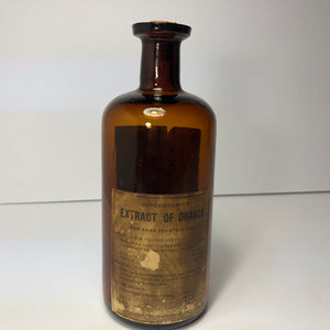 Extract of orange antique bottle, glass with label