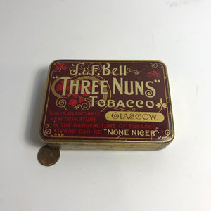 Scale of Three Nuns Tobacco tin by J&F Bell