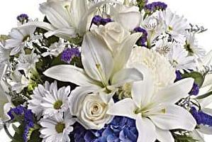 white lily with a touch of blue flowers, perfect for a baby boy.