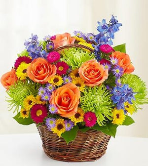 Orange roses with colorful seasonal blooms perfect for Birthday flowers!