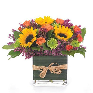 Sunflowers with bright and colorful flowers in glass vase for any occasion.