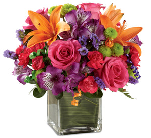 Hot pink roses with orange, green and purple flowers make the perfect Birthday flowers to send.