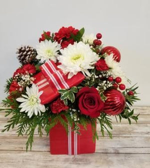 Fun christmas arrangement in red and whites delivered by florist in Winnipeg