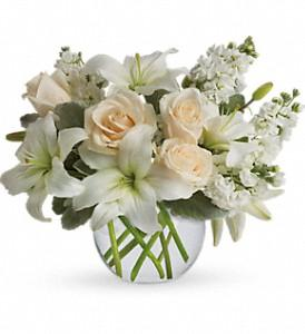 White flowers in clear vase  make a perfect gift for sympathy flowers.